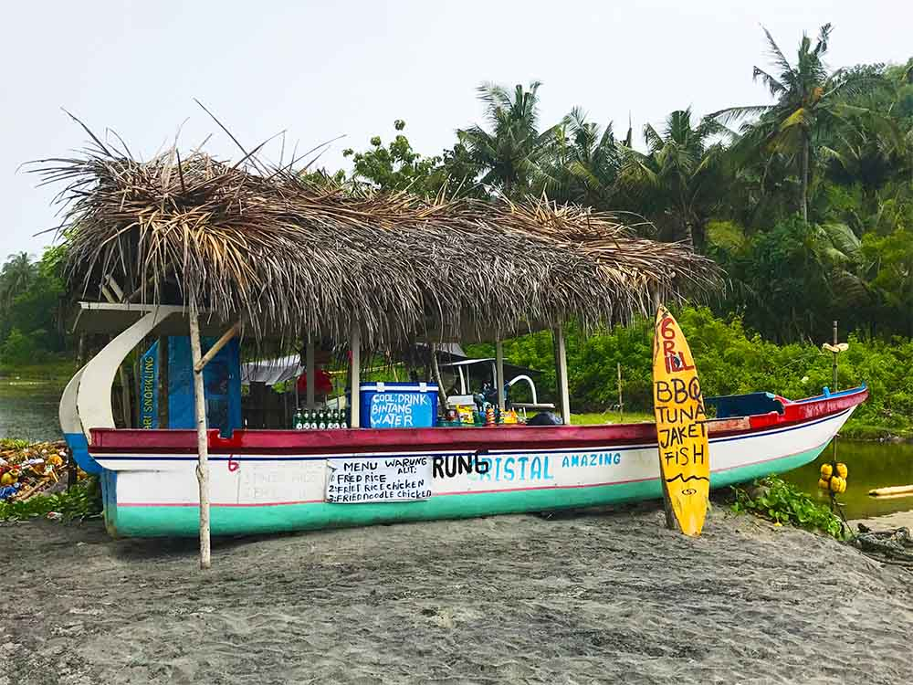 This fishing boat has been turned into a BBQ shack on Crystal Bay.