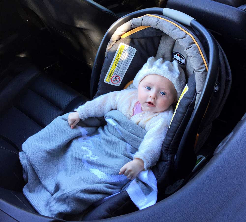 Rose in her car seat.jpg