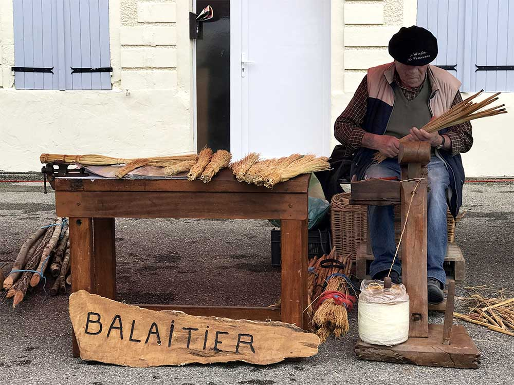 An artisan demonstrating how to make traditional brooms, at the annual Lavit de Lomagne fair.