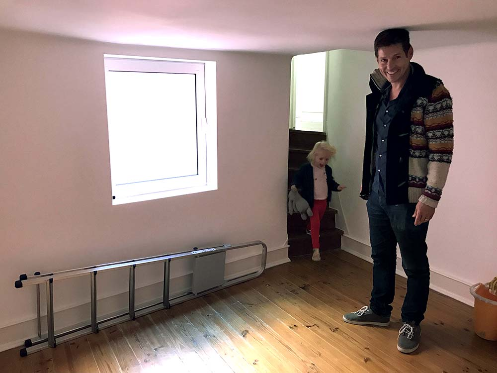 The 'bonus' room. Justin is 6' tall and can't stand upright in this room, but it could work as a kid's bedroom or playroom.