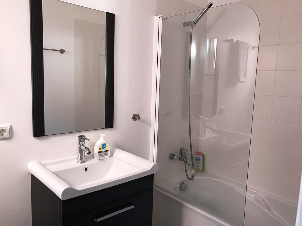 The bathroom is compact, but it's also clean and functional.