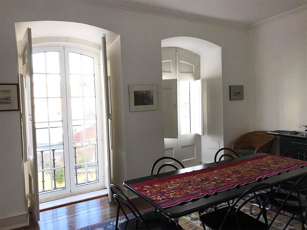 The living room has floor to ceiling windows, that open onto Juliet balconies.