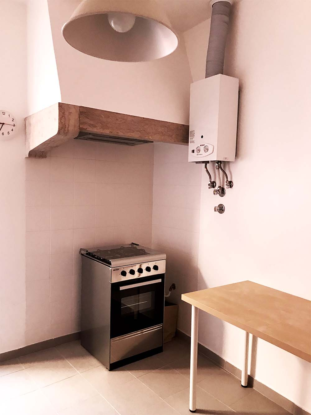 We'll add a counter-top to surround the oven and replace the freestanding table.