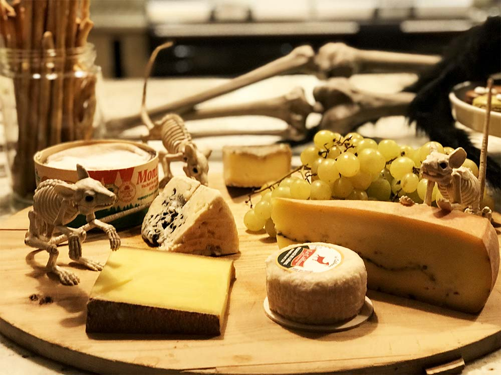 Some beautiful French cheeses, infested with skeleton rats.
