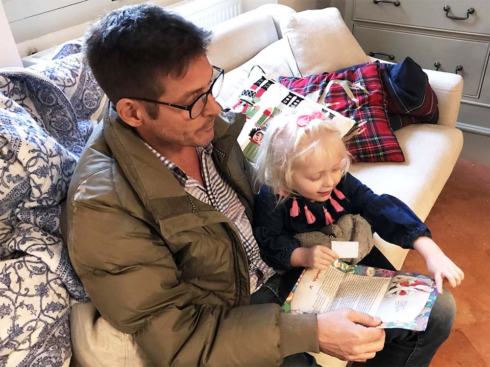 Justin reading Santa's letter to Rosie. Look at her face!