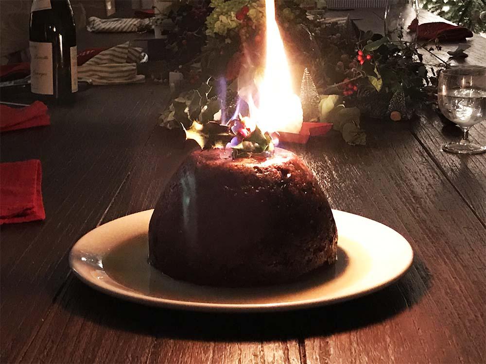 The Christmas pudding, set alight.