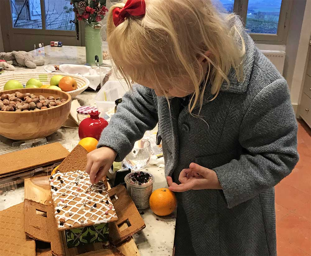 Rosie didn't care that her gingerbread house had collapsed. We balanced the roof on a tissue box and she bedazzled it just the same.