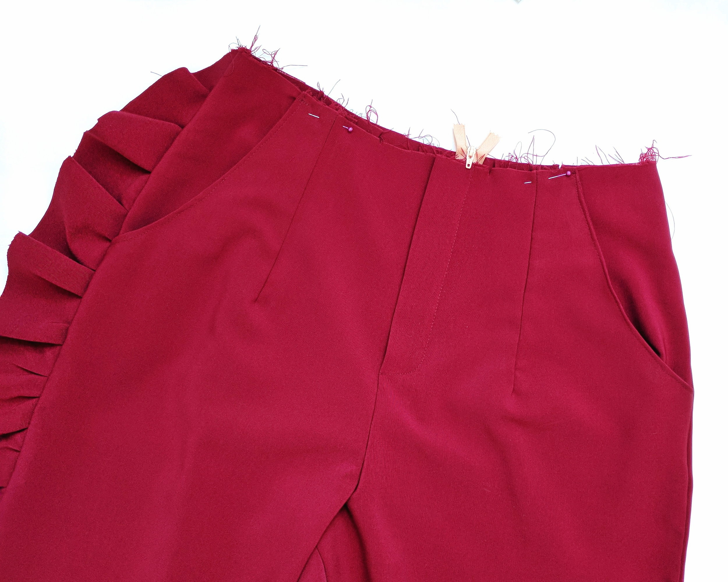 Pattern: 6901 - Modifications: Cut out a long curved strip of fabric (the length of your pant leg) gather one edge to create the ruffle. Sew it into the side seam.