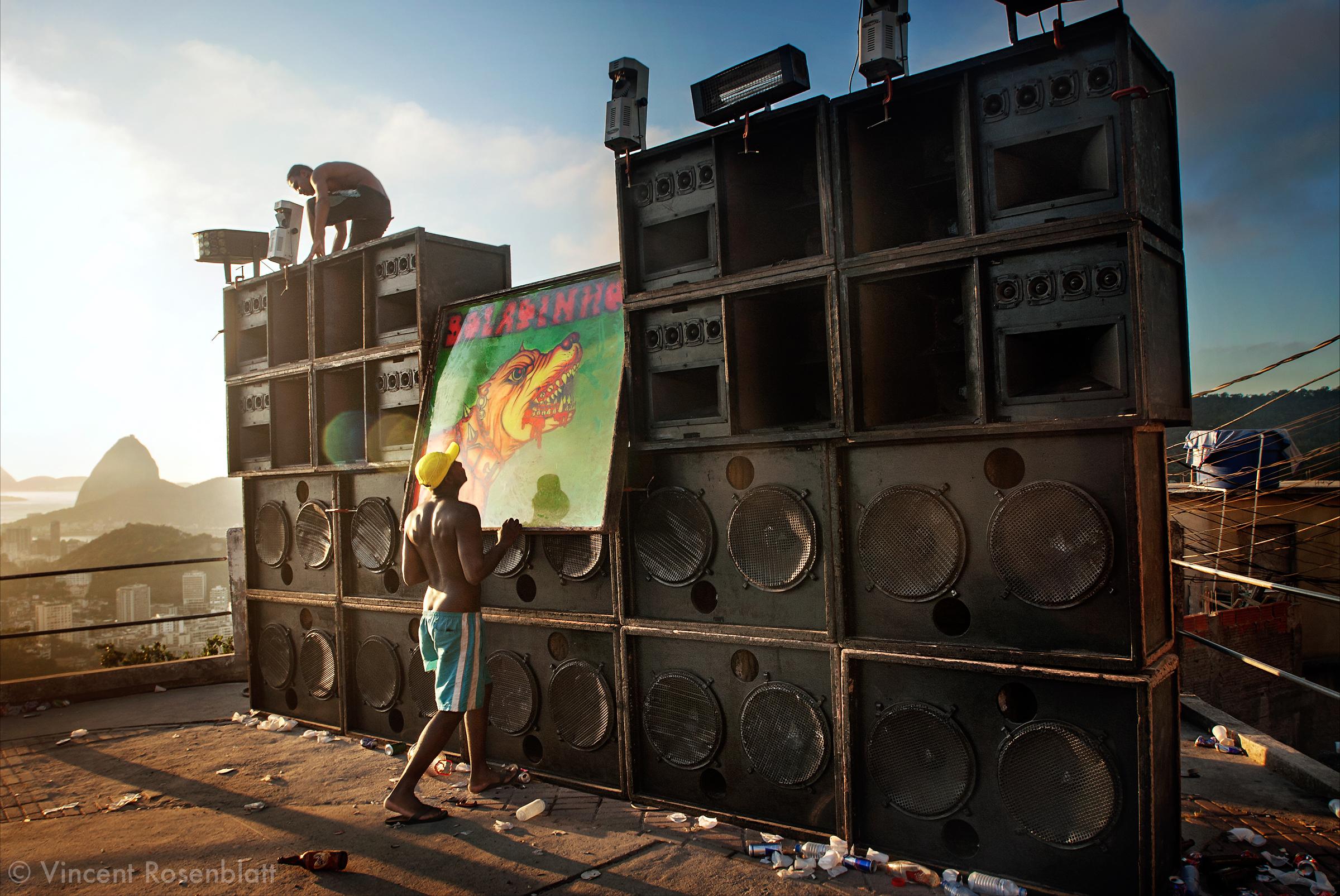 """7AM. Dismounting the soudsystem Pitbull - Boladinho after the """"baile funk"""" on the top of the favela Morro dos Prazeres. Rio de Janeiro 2007."""