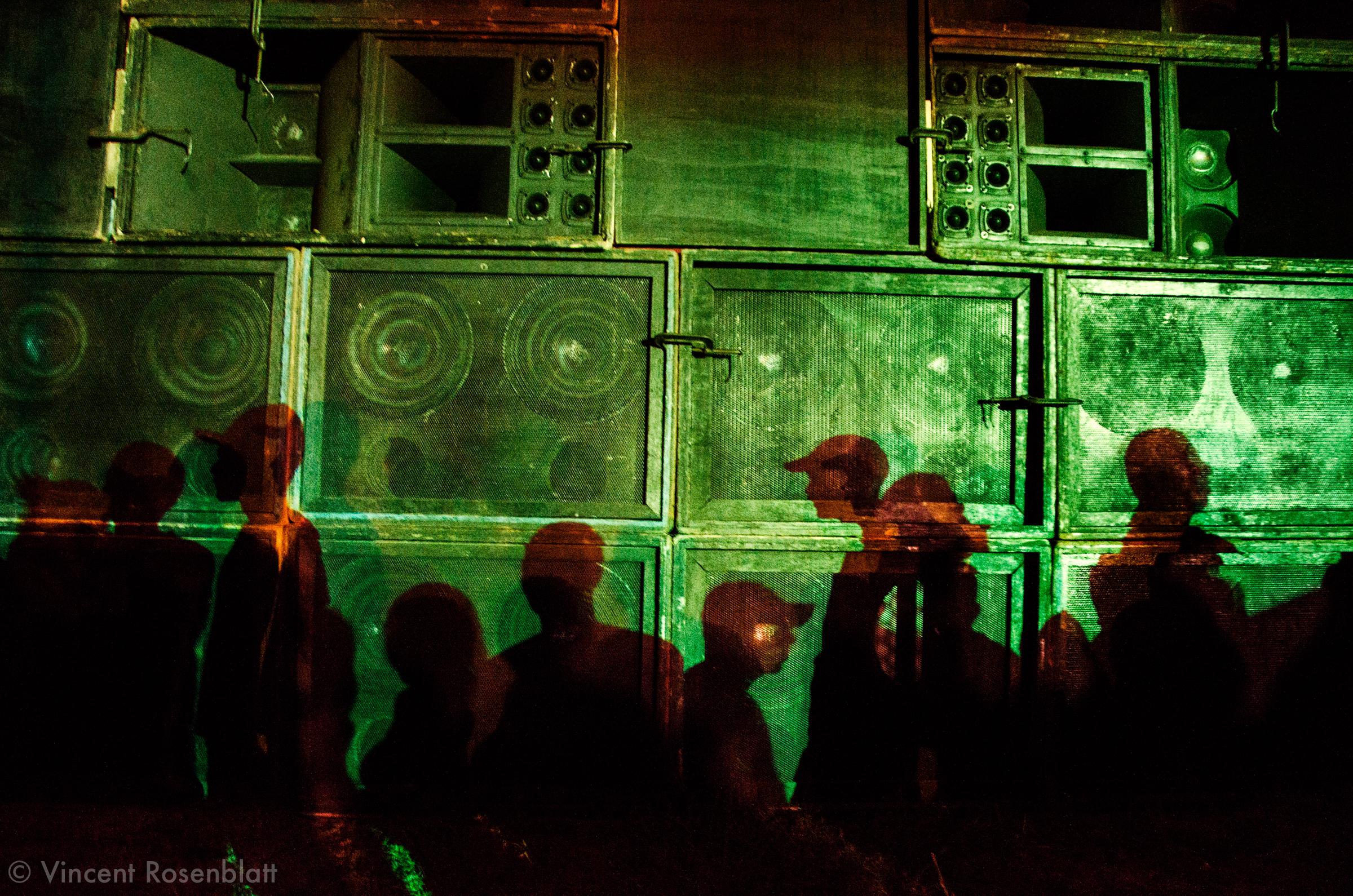 """Shadows of the """"Funkeiros"""" enjoying the Baile Funk with the Chatubão Digital soundsystem & DJ Byano performing at the Fazenda F.C club in São João do Miriti, suburb of Rio de Janeiro, 2011"""