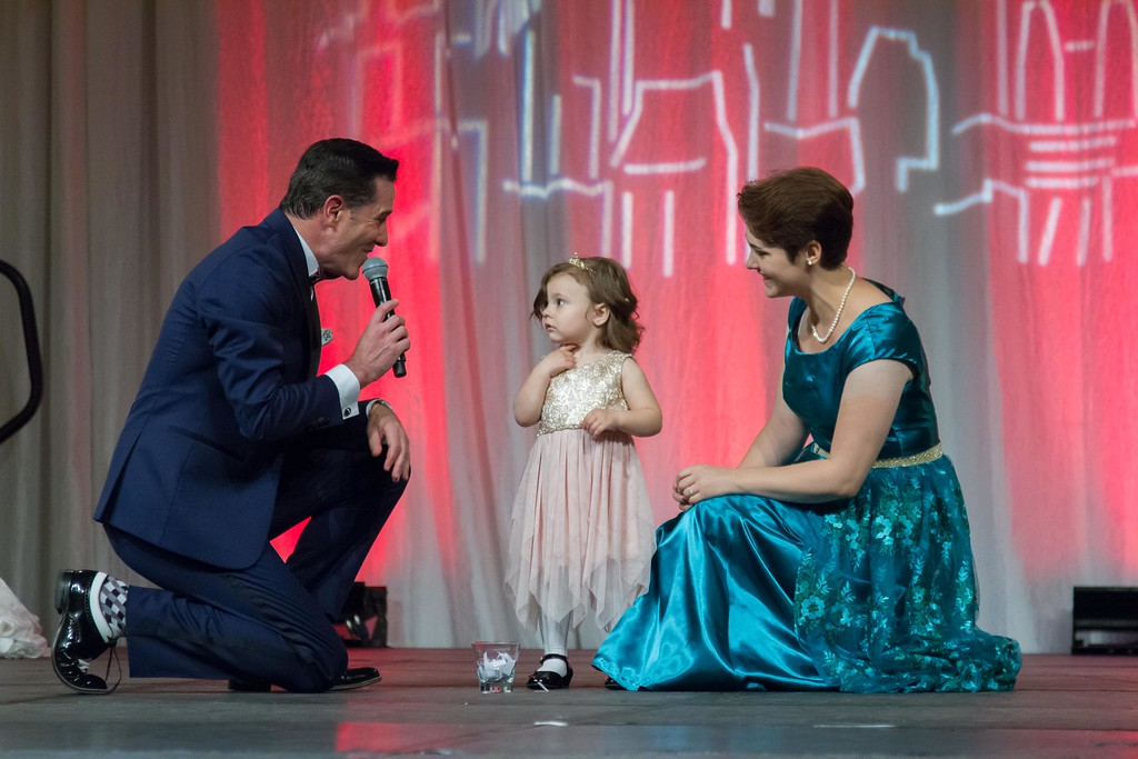 Matt is joined on stage by 2-year-old cancer survivor Ruth, who picked the winning raffle ticket for Cancer Pathways Surviving with Style Gala.
