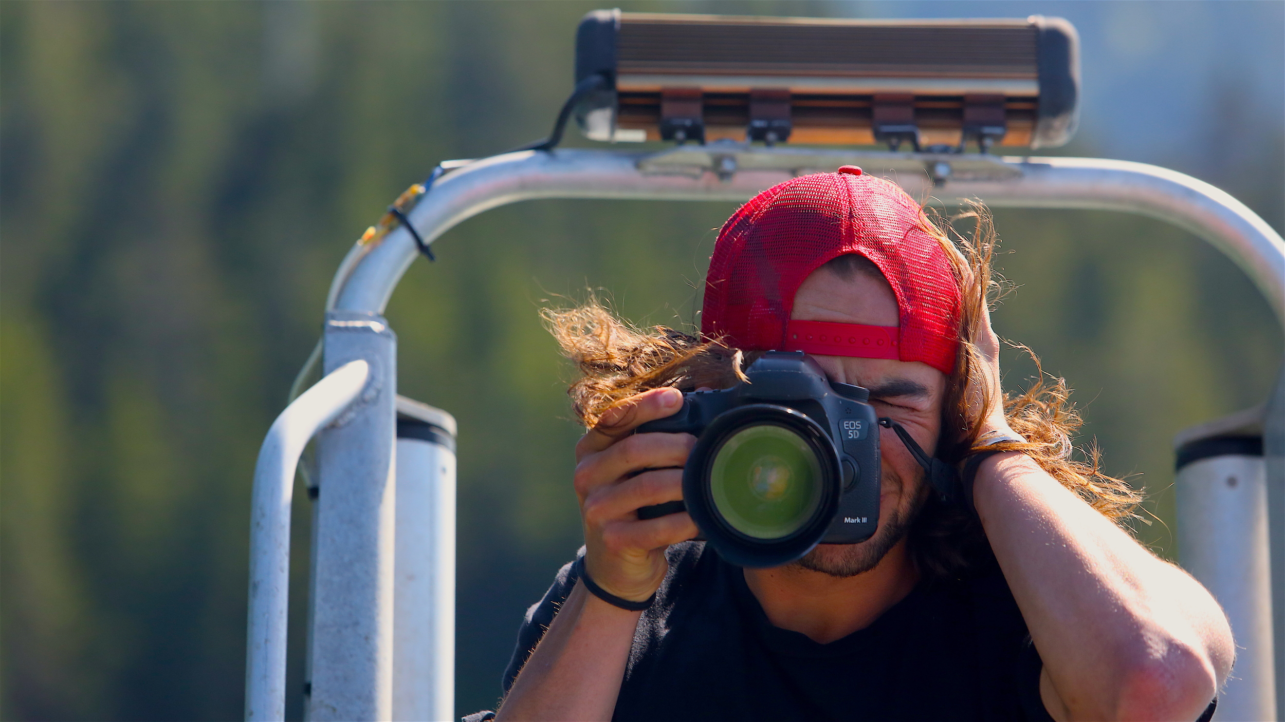 Will Saunders photographing the boating adventure with Dune Lankard