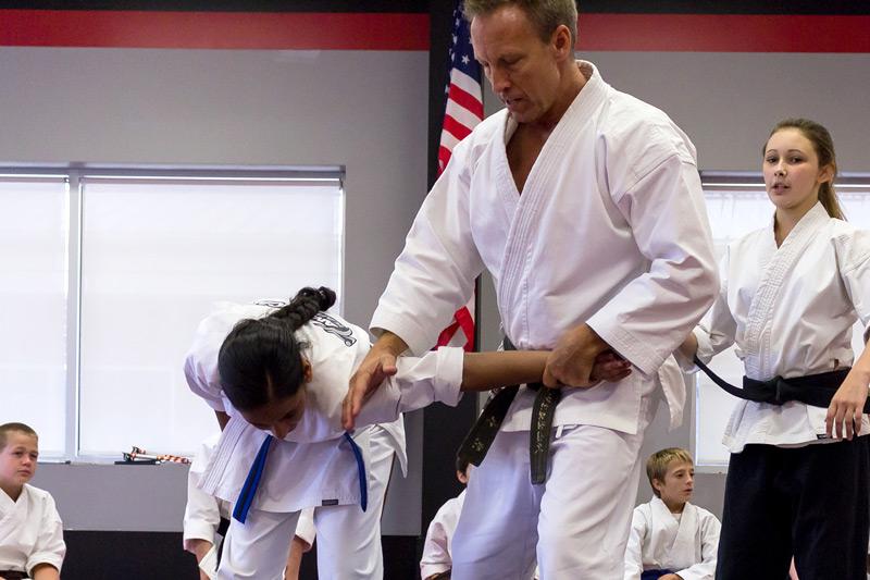 Mr. Norton teaching self-defense in group private karate lesson.