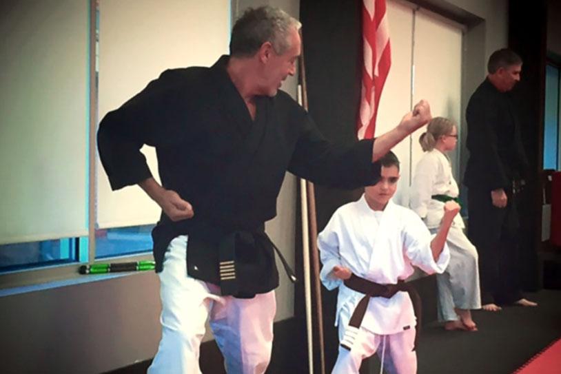 Mr. Sutton teaching student at American Karate