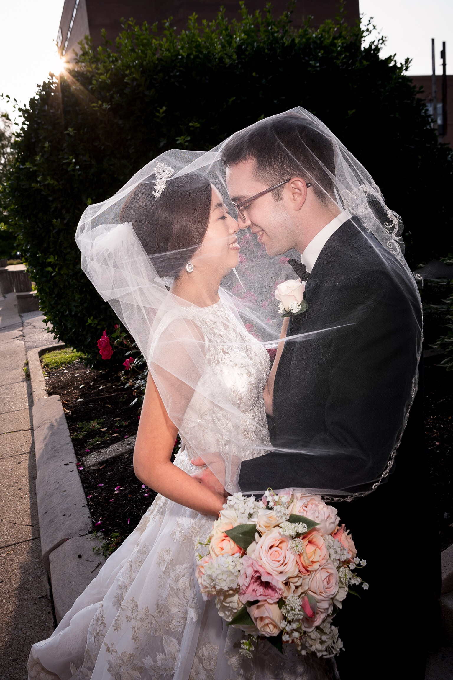 Bradley and Kate spend a few intimate moments under the veil after their ceremony at the Old Medical School Building in louisville