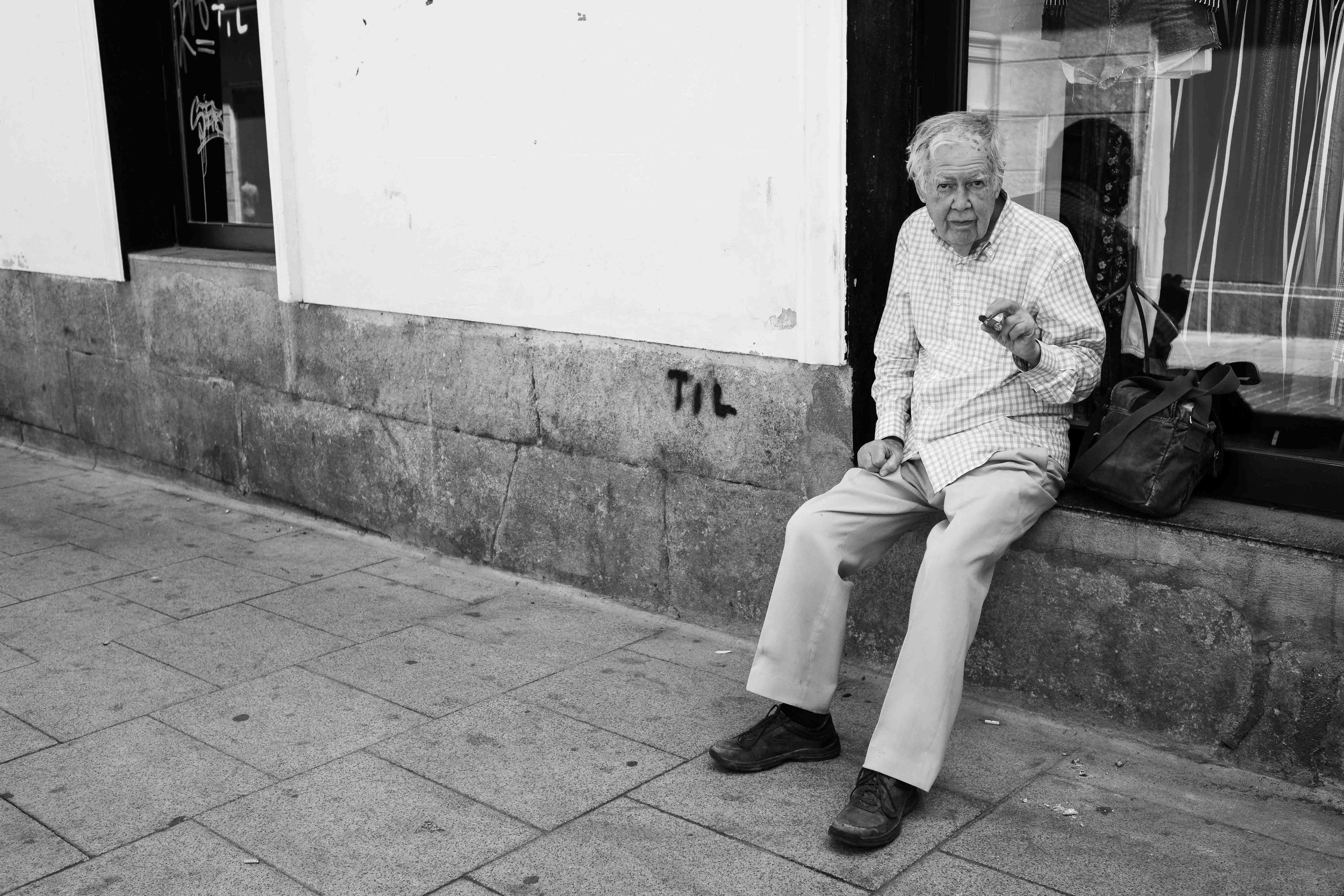 Old man with cigar.