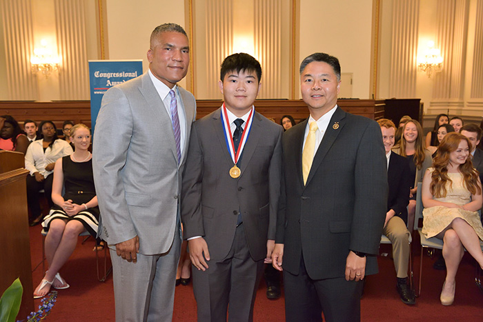 Courtesy of Fritz PhotoGraphics   Terence Lee, center, wearing his Congressional Award Gold Medal, is flanked by Congressional Award Chairman Paxton K. Baker, left, and U.S. Rep. Ted Lieu.