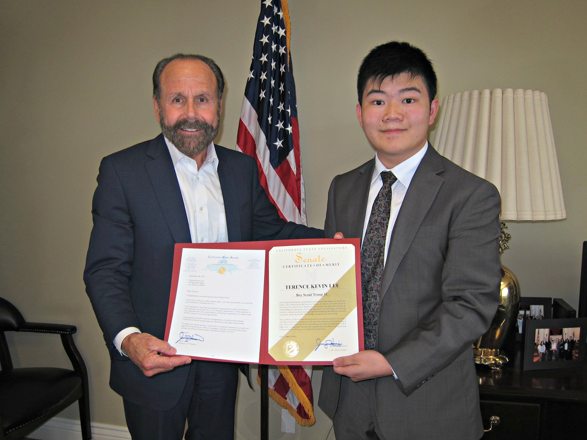 Senator Jerry Hill (left) presenting Certificate of Achievement to Eagle Scout Terence Lee (right)