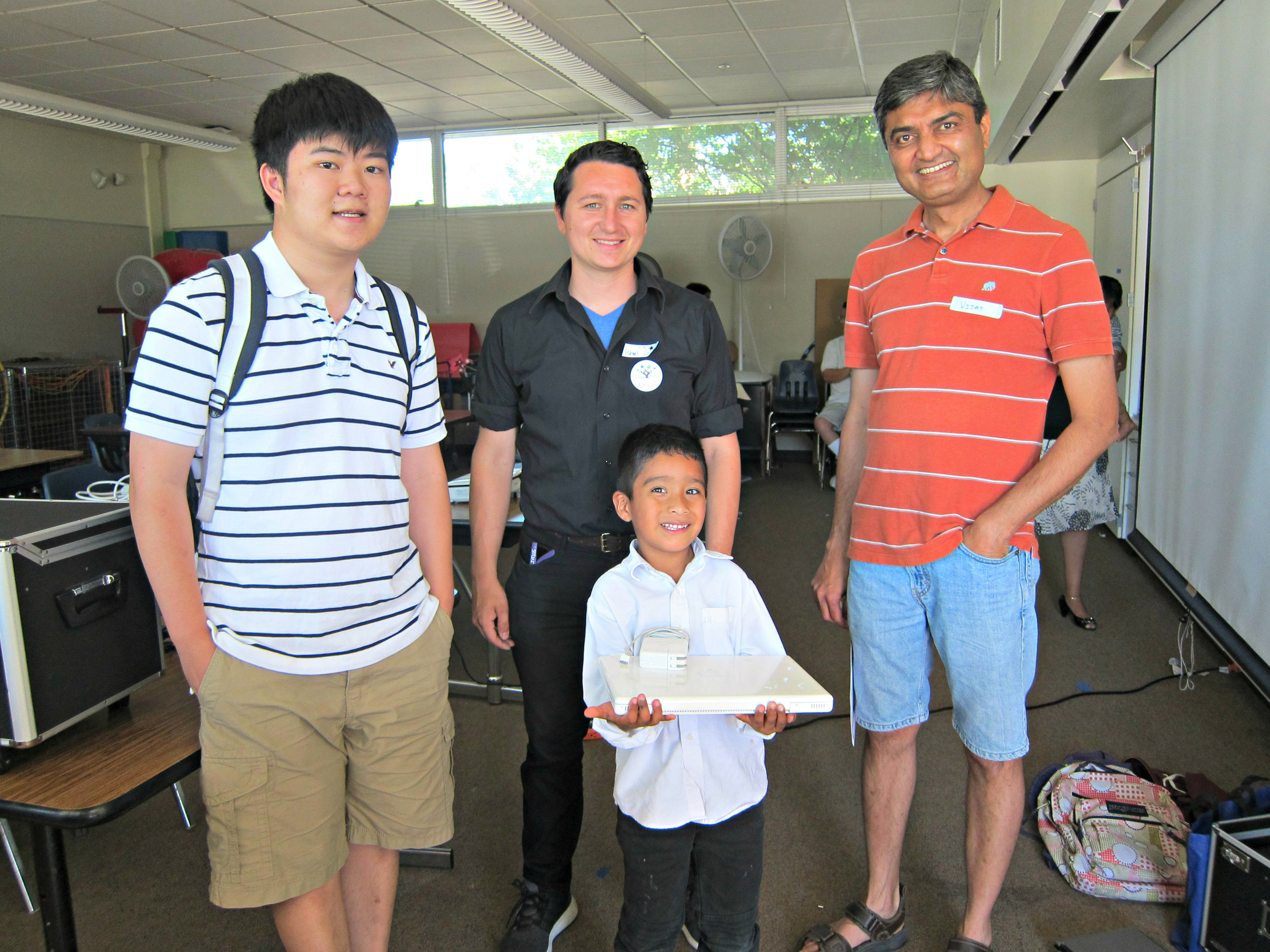 Laptop awarded to kids from low income family.jpg
