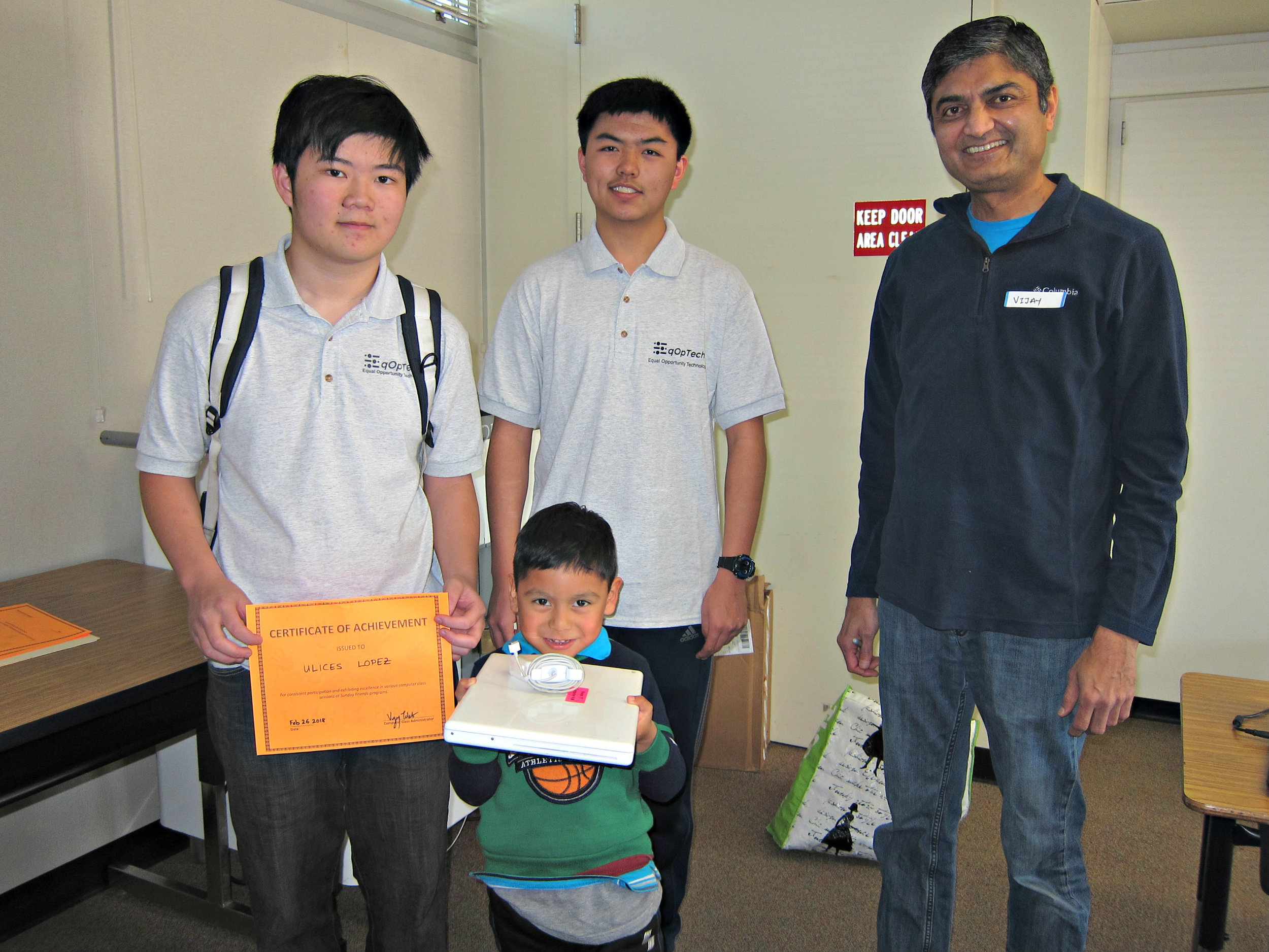Terence Lee (left), Kevin Gao, Vijay Talati - kid earning his first refurbished laptop at Sunday Friends