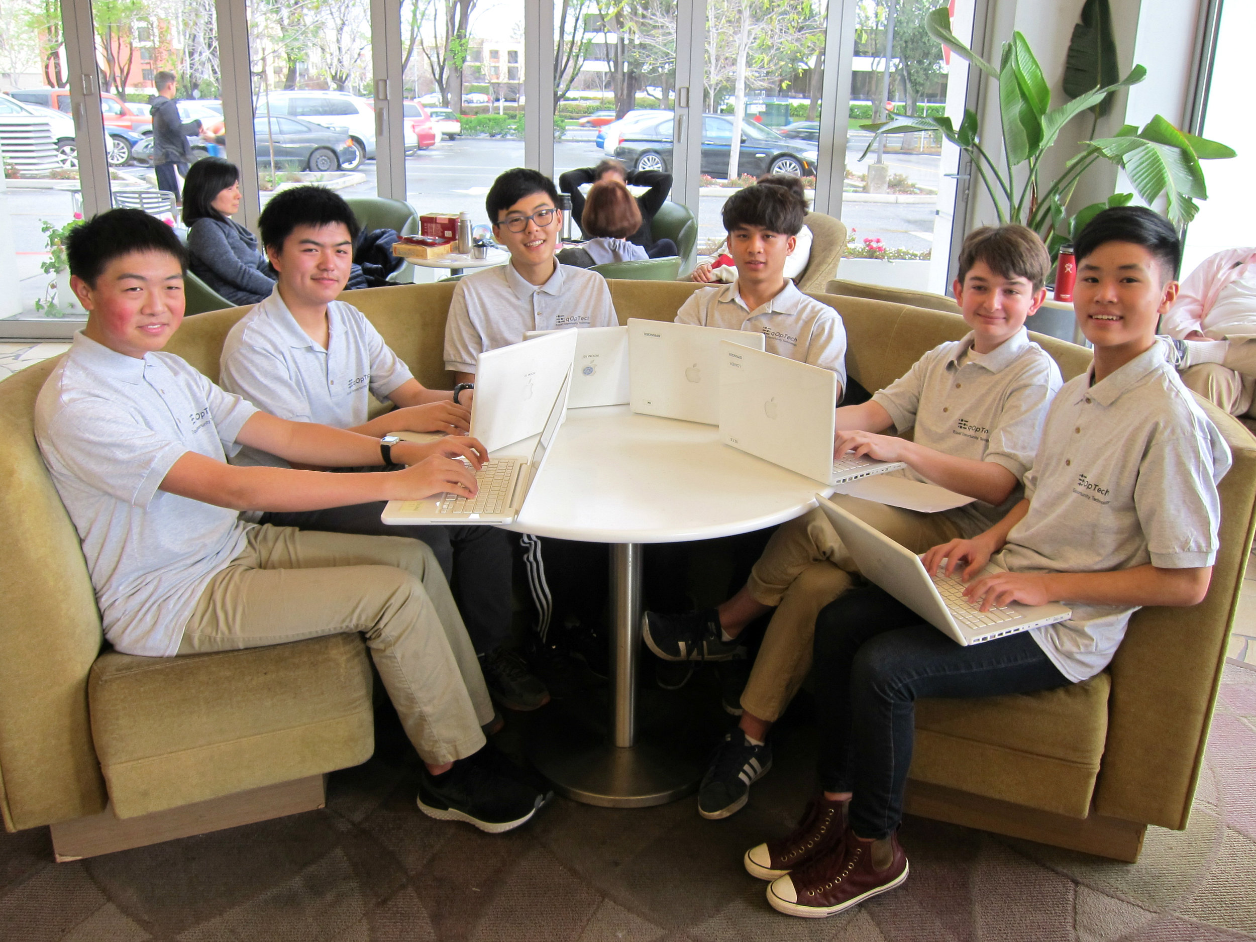Eric Che, Kevin Gao, Daniel Lim, Nate Latif, Trevor Smith, Cedric Chan (left to right) refurbish computers for at-risk students