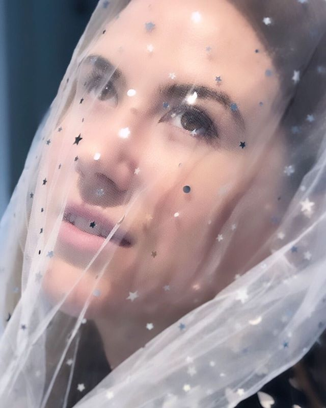 The face of a woman who was never bothered about marriage until she tried on a £1 veil on a hen do.
