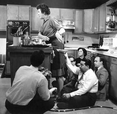 Julia Child and a TV crew during the taping of one of her shows. Photo: Paul Child