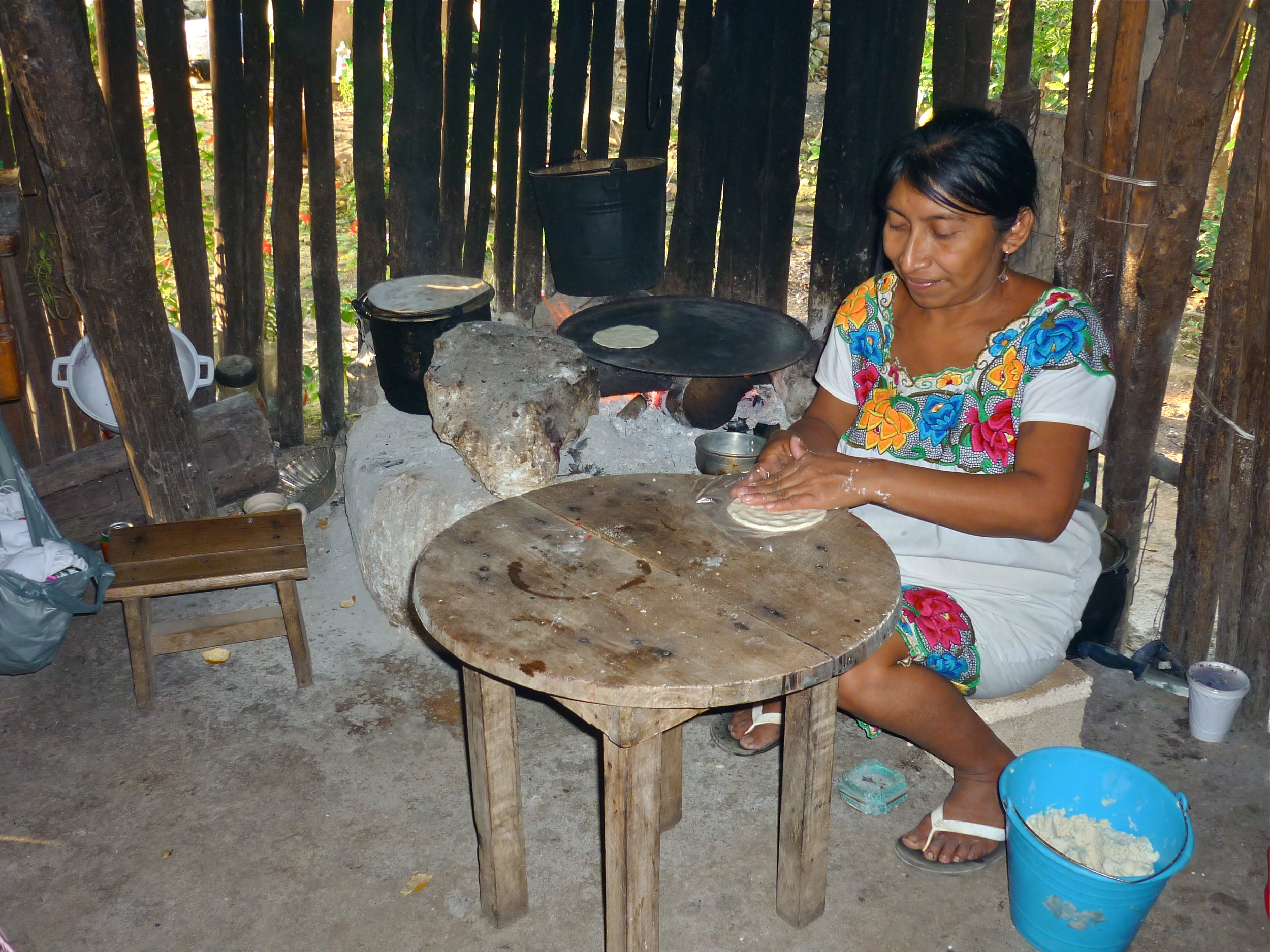 Maya woman cooking tortillas