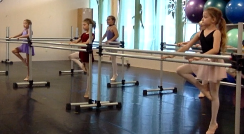 7 and 8 Year Old dancers practicing retiré devant