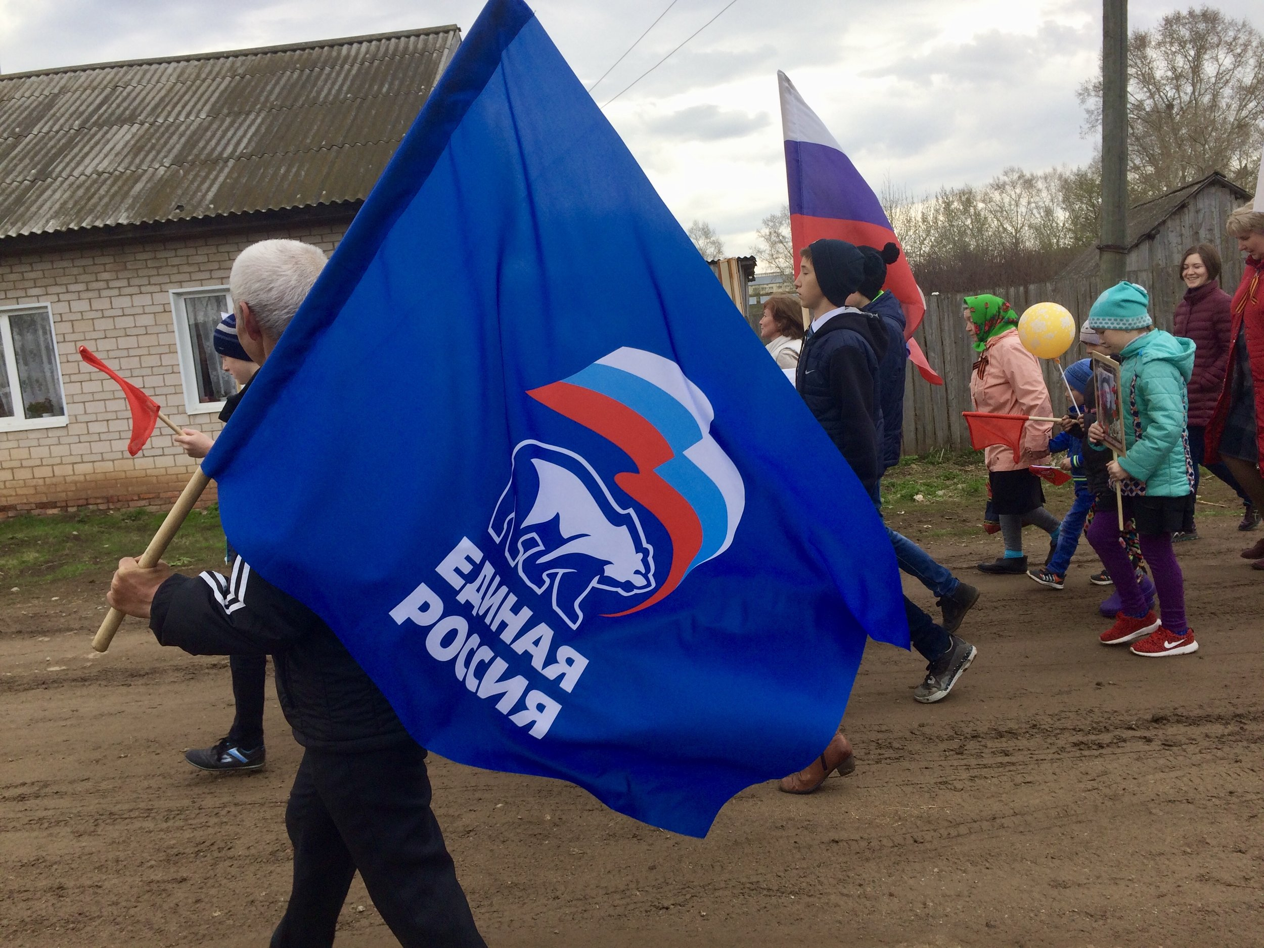 United Russia's flag on display at a Victory Day march in rural Russia, allegedly a national and non-political holiday.