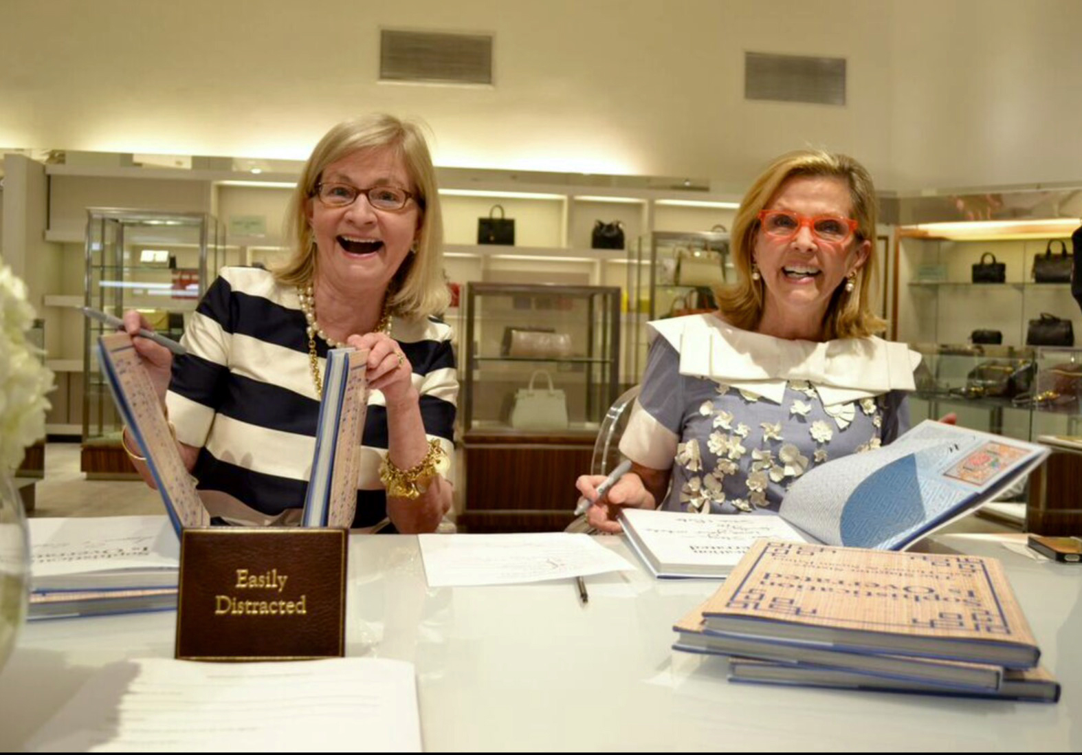 Babs (left) and Susan easily distracted while signing books!