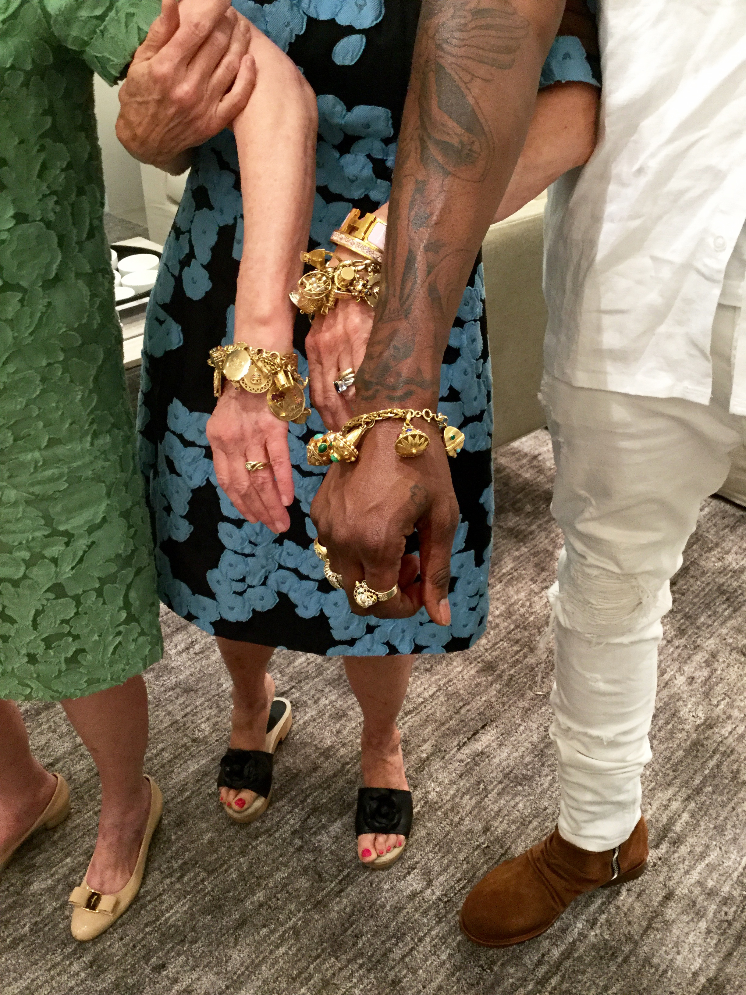 Susan, Babs, and 2 Chainz showing off their charm bracelets!