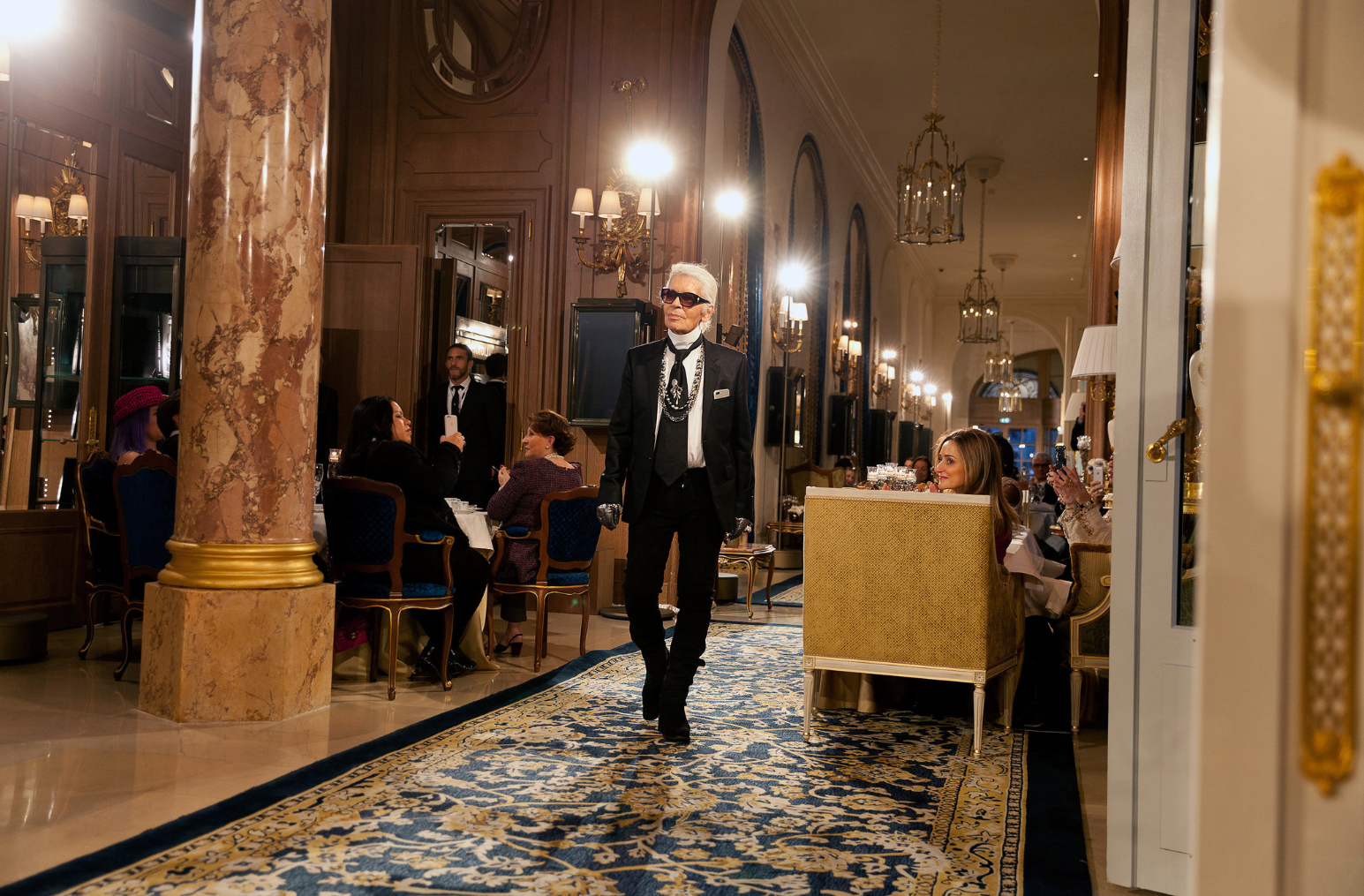 Karl Lagerfeld taking a bow after the Chanel Métiers d'Art Show on December 6th. Image via T Magazine - The New York Times.