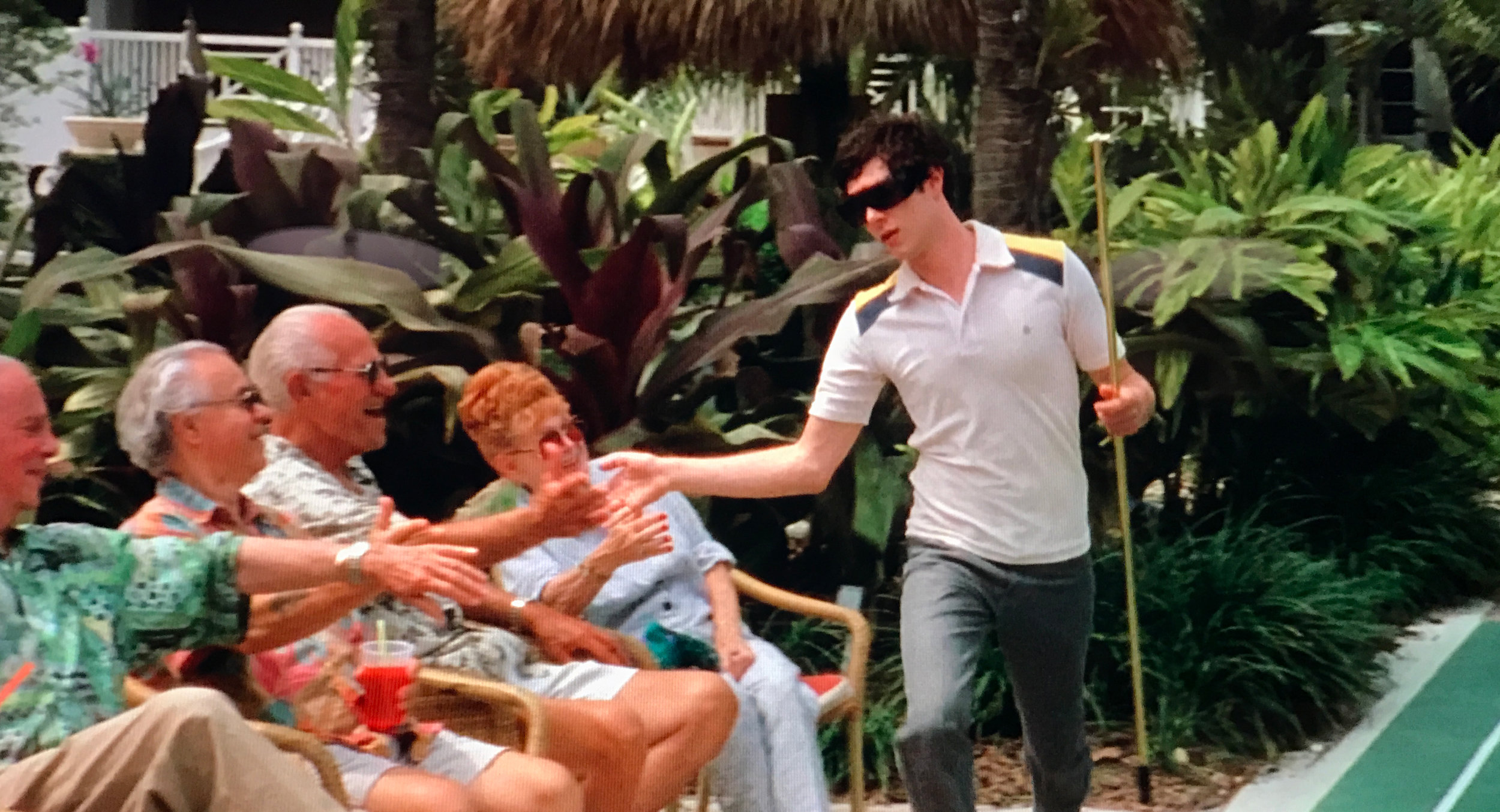 Seth Cohen playing shuffleboard with his Miami friends in The OC Season 2, Episode 21,  The Return of the Nana .