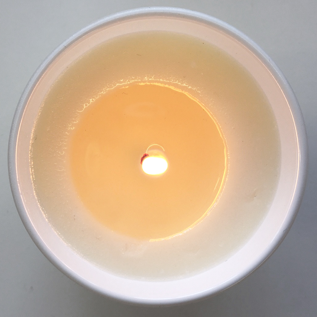 A candle beginning to tunnel. Notice how it is not burning through evenly. Image via Field Day.