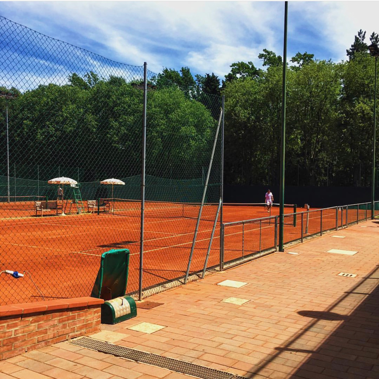 The red clay courts at the exclusive Circolo Tennis Bologna, hidden within the Giardini, as the Bolognese call them.