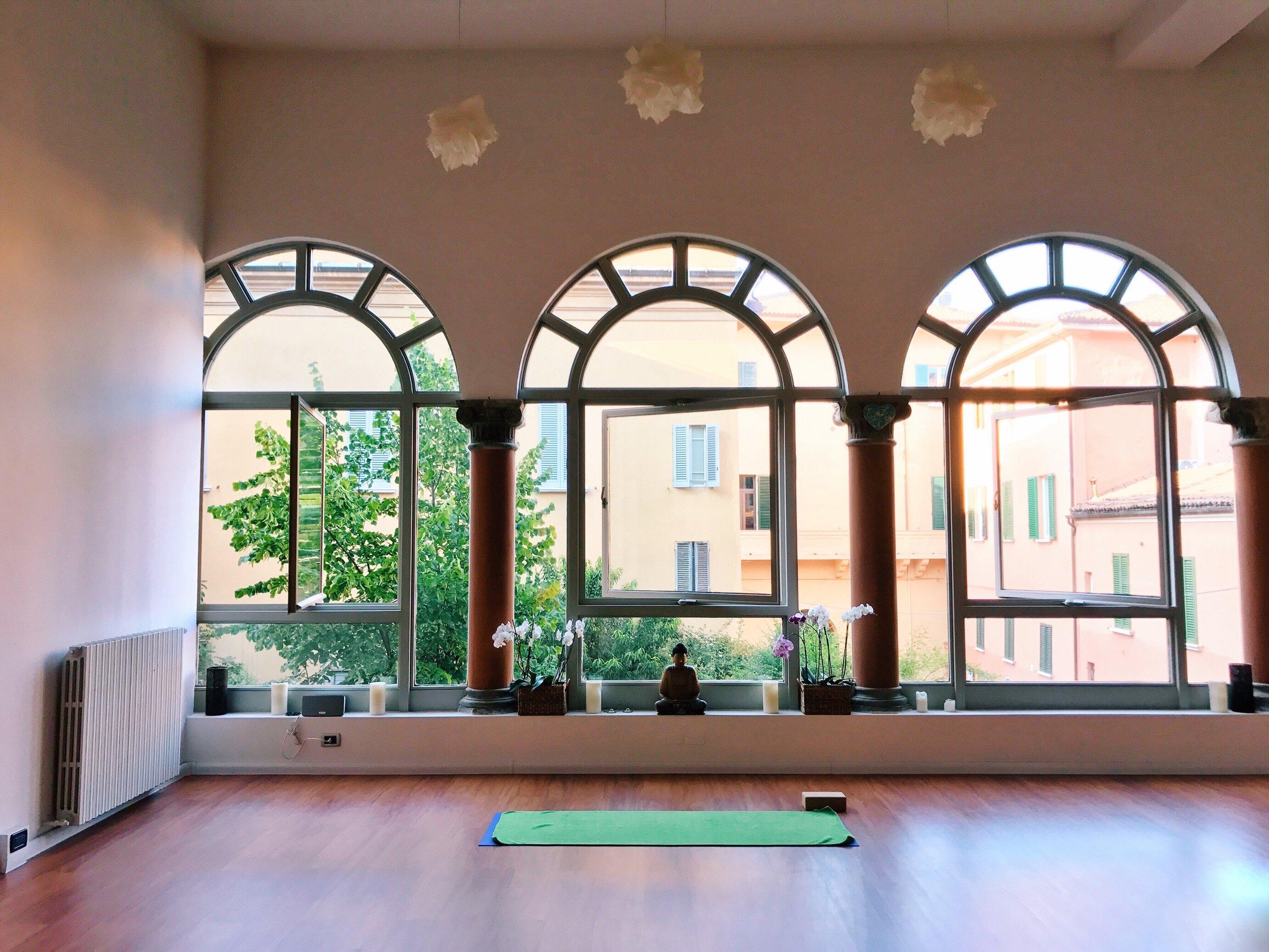 The vibrant light-flooded yoga studio in Strada Maggiore.