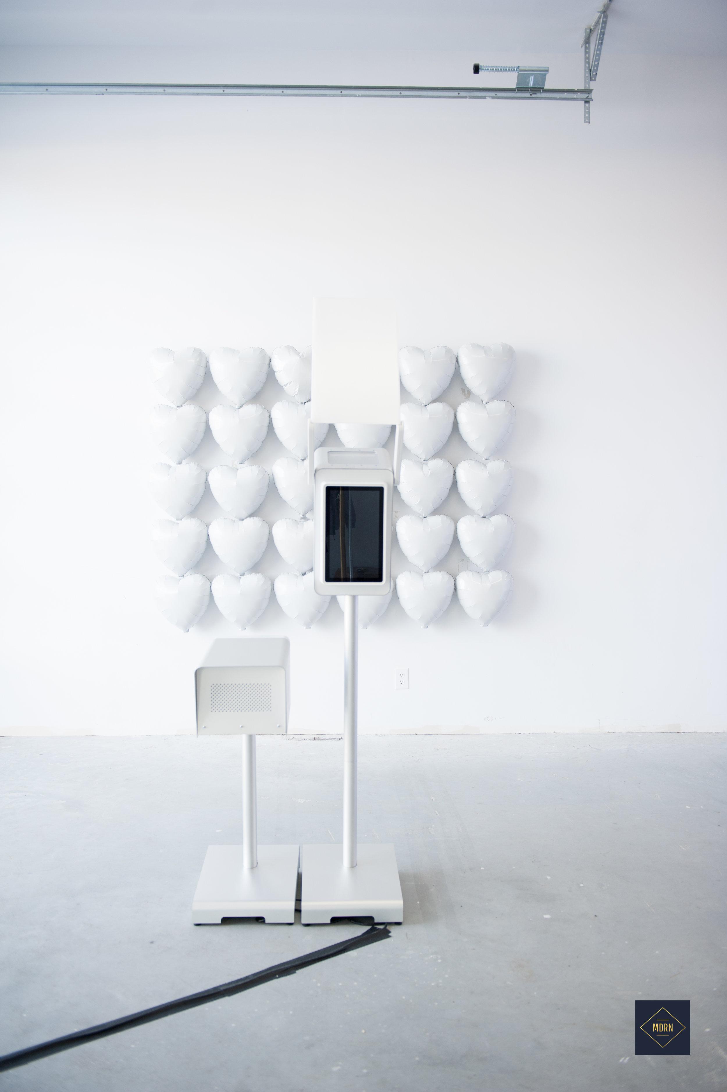 White Monochrome balloon backdrop and all white photobooth