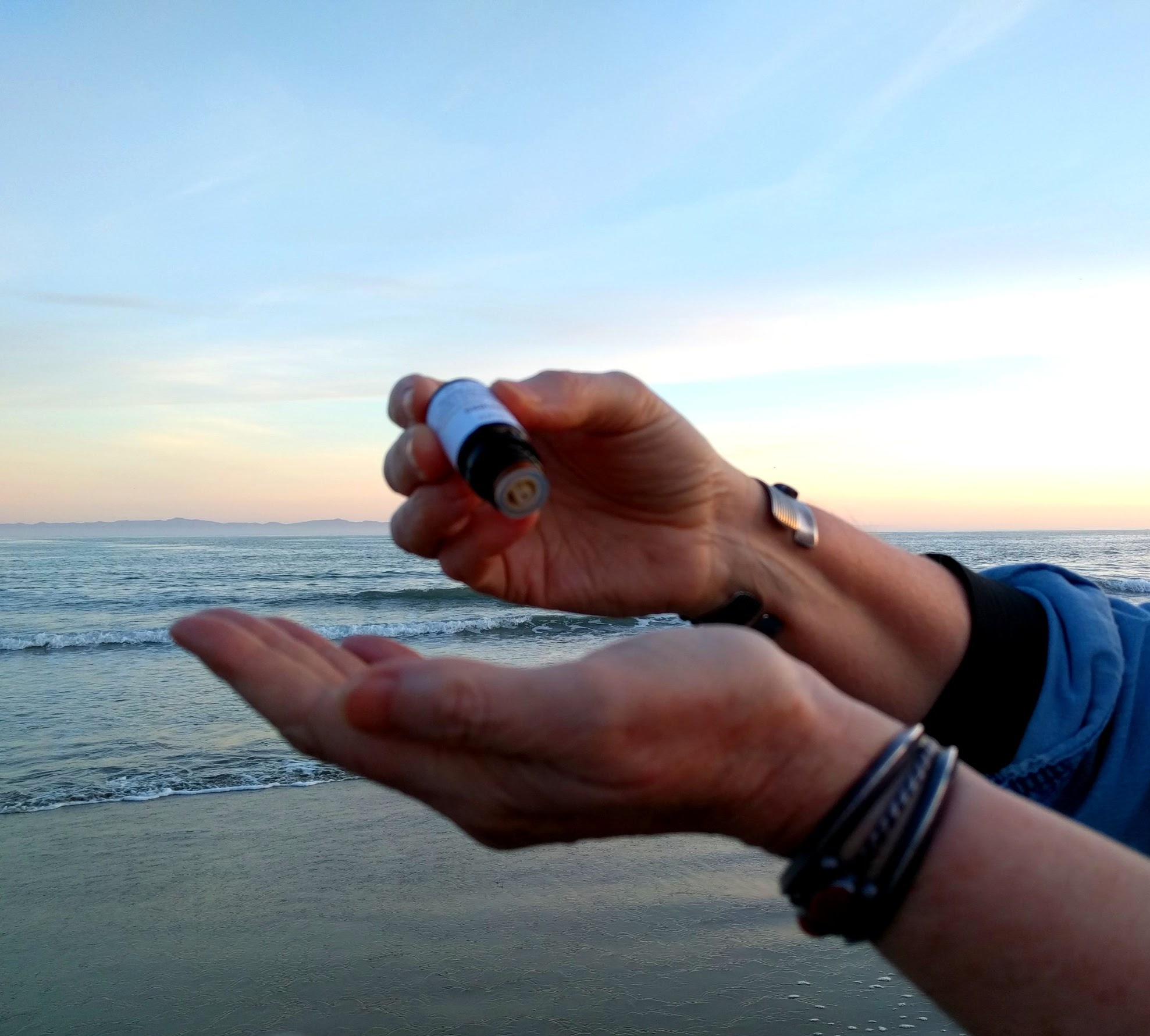 Hands oil sunset drops.jpeg