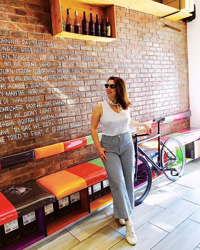 """I like to be surrounded by splendid things.""—Freddie Mercury 👑 . I found this colorful wine bar in Stellenbosch, South Africa. 🍷 . Walls of music references and good reds and whites? My hero would be proud. 🚲 . . . . . . . . . . . . . #meetsouthafrica #stellenbosch #capetown #winebar #queen #freddiemercury #travelgirl #sheisnotlost #travelgram #lifewelltraveled #travellikeagirl #travelwriter #globewanderer #travelalways #girlgoneglobal #wandergram #westerncape  #capewinelands #writetotravel #nomore9to5"