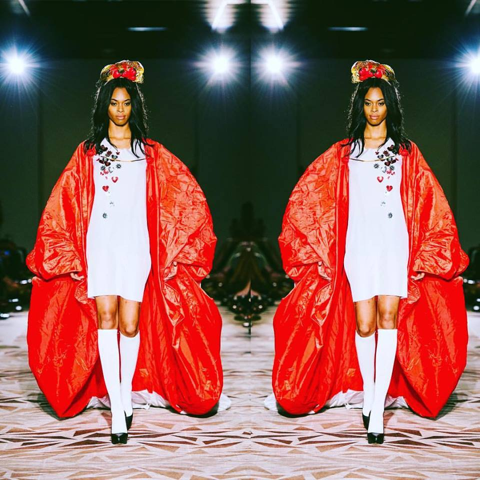 """""""A collection that is anything but boring, THIS IS SLOANE brought zany character to Austin Fashion Week 2016. The playful runway line-up by 20-year old designer and Austin resident,Sloane Lenz, was inspired by the life of one of her eccentric relatives in New York in the 50's, 60's and 70's as she imagined it. The dreamy details play out on the runway with a sense of humor and boldness that demonstrate this daring, youthful artist's passion to create and express art with no bounds.  Sloane learned to sew at eight years of age and first began crafting unusual frocks made from materials sourced at her local grocery and hardware store. Over the years, she has developed a preference for plastic and canvas. The avant-guarde artist has also dabbled in blogging as co-founder  ALLUMER which covers music, style and culture.""""    http://oletalifestyle.com/2016/04/anything-but-boring-this-is-sloane/"""