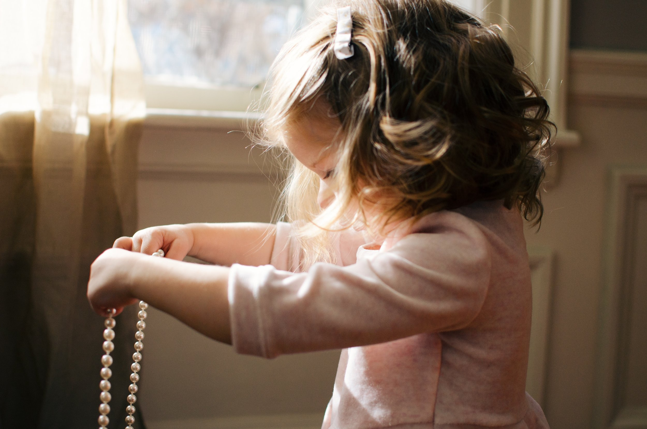 Little girl with pearls