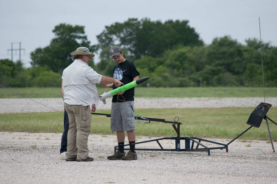 Team member having his L1 rocket inspected before his certification flight.