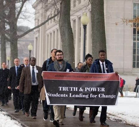 """The """"Truth & Power: Students Leading for Change"""" MLK Celebration program began with a silent march starting at Lobby 7 and ending at Walker Memorial Hall, February 2016.   Front row, left to right:    Alberto Hernández    '17     and    Rasheed Auguste    '17."""