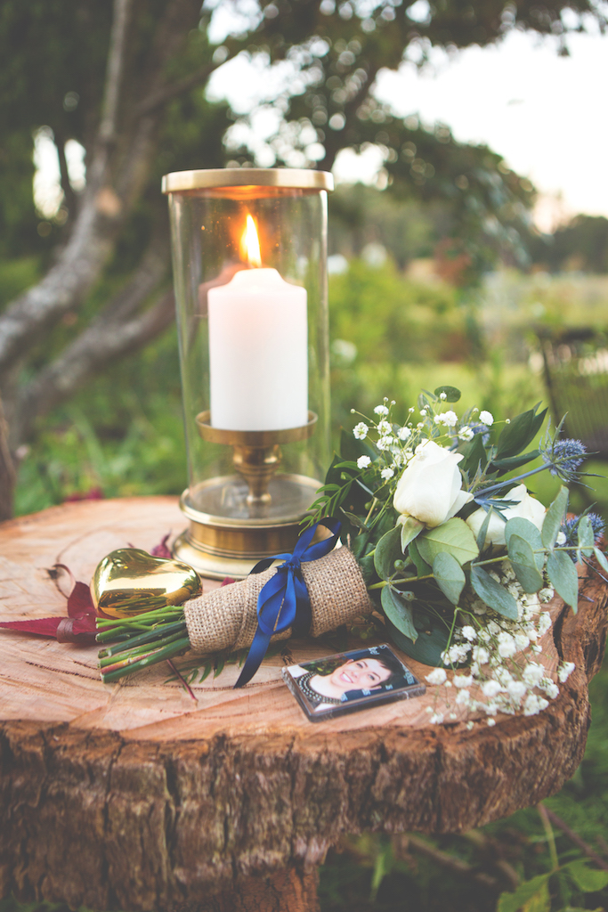 Kate's tribute to Laura - Laura's bouquet, candle, photo and heart on a handmade table