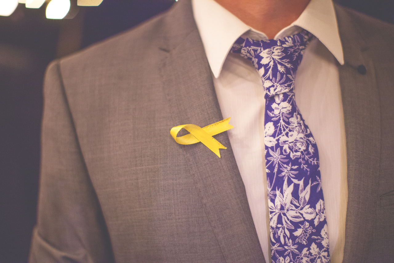 A wedding guest wearing the yellow ribbon in support of Stop Sarcoma
