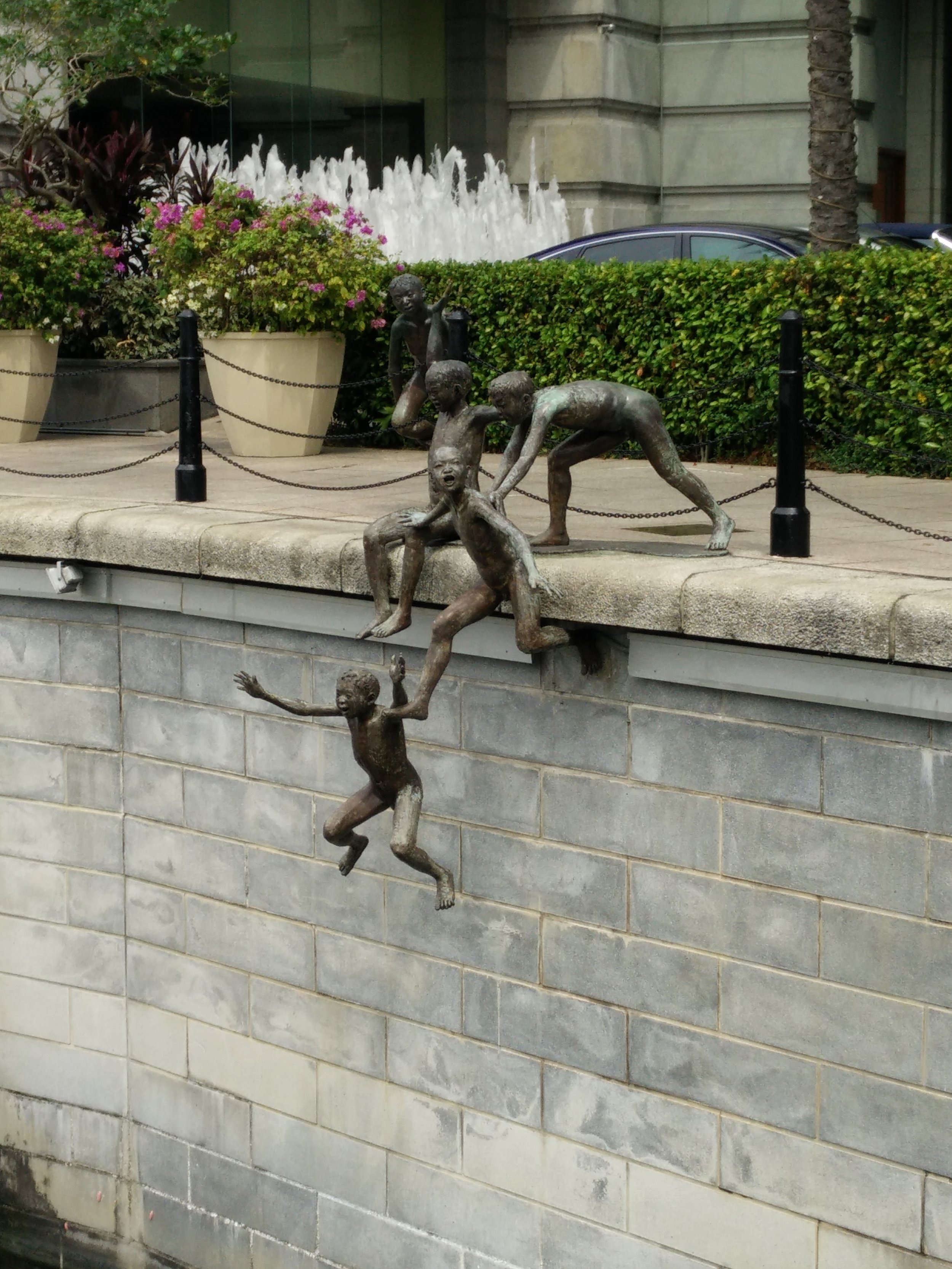 First Generation, by Chong Fah Cheong - possibly the most famous sculpture in Singapore, a group of boys playing in at the riverfront