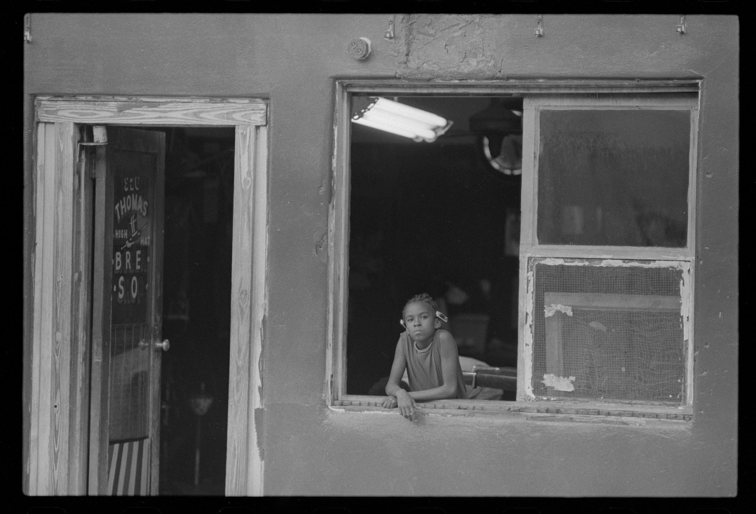 Ghetto_Girl_in_Window_062774_F23.jpg