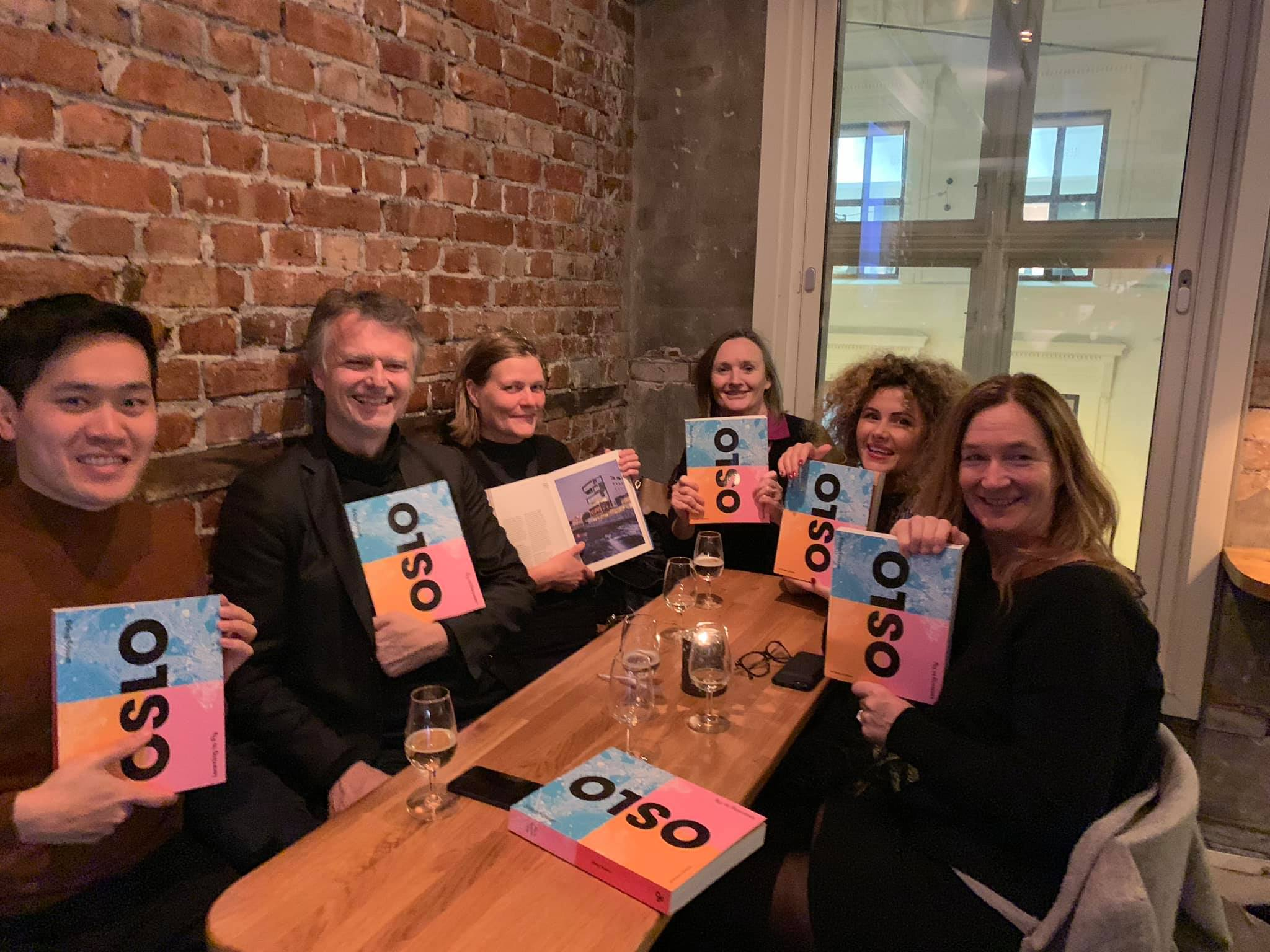 """Oslo - Learning to Fly"", Coming to a Bookstore Near You! - 18.12.2018 - Kulturhuset, Oslo - Oslo - Learning to Fly is Erling Fossen's new book on Oslo city's transformation, encompassing decades, generations and urban ideologies. The book attempts to summarise a not-seen-before collection of minor and major projects from the past, present and future! Tin was one of the 29 contributors (millenials category) in the book, with the title ""Enriching the Urban Vocabulary"". Tin's contribution talks a lil' bit about Barcode, Mesh, Bergen Media City in a span of 1 page. Tin applauds Erling Fossen for his structure of the book; for how he spend 50% of it on pictures, 25% on contributions from others, and the rest he writes himself in as the sole author of the book! Nice bizniz tactics, Erling; minimum effort, maximum reward! No royalties whatsoever, were discussed among the 29 contributors.From the left; Tin Phan, Erling Fossen, Marianne Skjulhaug, Elin Børrud, Dana Jdid, Anne Beate Hovind. Omg Marianne, close the book - you're out of sync! Other esteemed contributors were among others Ellen de Vibe, Kamzy Gunaratnam, Knut Schreiner etc."