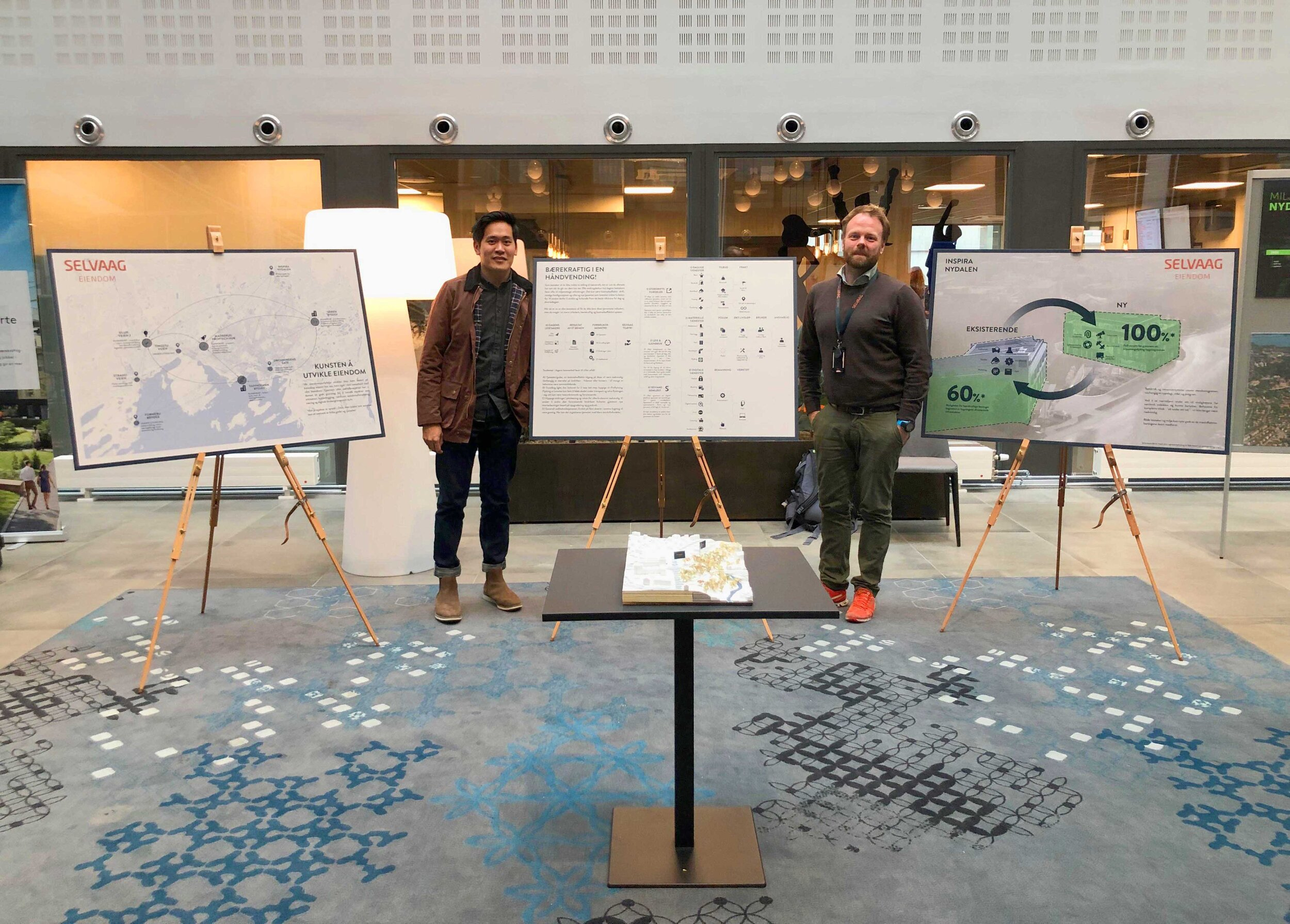 Chief Designer of Selvaag's Exhibition at Bydelsdagene Nydalen! - 14.09.2019 - Avantor H.Q., Nydalen - Tin served as the chief designer of Selvaag's exhibition at Bydelsdagene Nydalen, working under the director of Development Magnus Skallerud (right in the picture), and property developer Emelie Tornberg. The intention was to showcase different property developers practices that underscored the green shift. Instead of showing anything flashy as BREEAM certified buildings, Selvaag chose a more sober representation of their innovations: their everyday practices such as putting pressure on suppliers to step up their game on maintaining ventilation rather than replacing it, proper storage of furnitures for reusing, system walls/doors etc., and even digital systems for smooth booking, ordering catering, paying bills etc. The point was to showcase the actions that a property developer could do which is leaner management of their furnish or assets in their properties, rather than buying state-of-the-art technological facades or whatever.Some of the presenters present that day was Elin Børrud, Per Gunnar Røe, Gro Sandkjær Hanssen, Øystein Thorup etc. Other property developers that exhibited their work that day was Avantor, OBOS, Veidekke, Norwegian Property and Storebrand Eiendom.